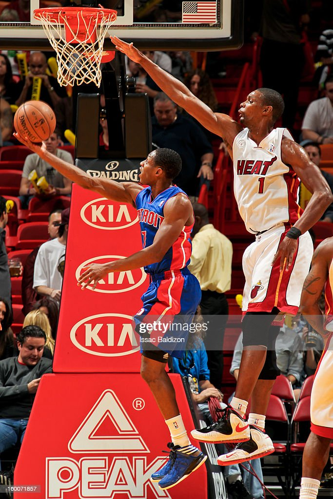 Brandon Knight #7 of the Detroit Pistons attempts a reverse layup against Chris Bosh #1 of the Miami Heat on January 25, 2013 at American Airlines Arena in Miami, Florida.
