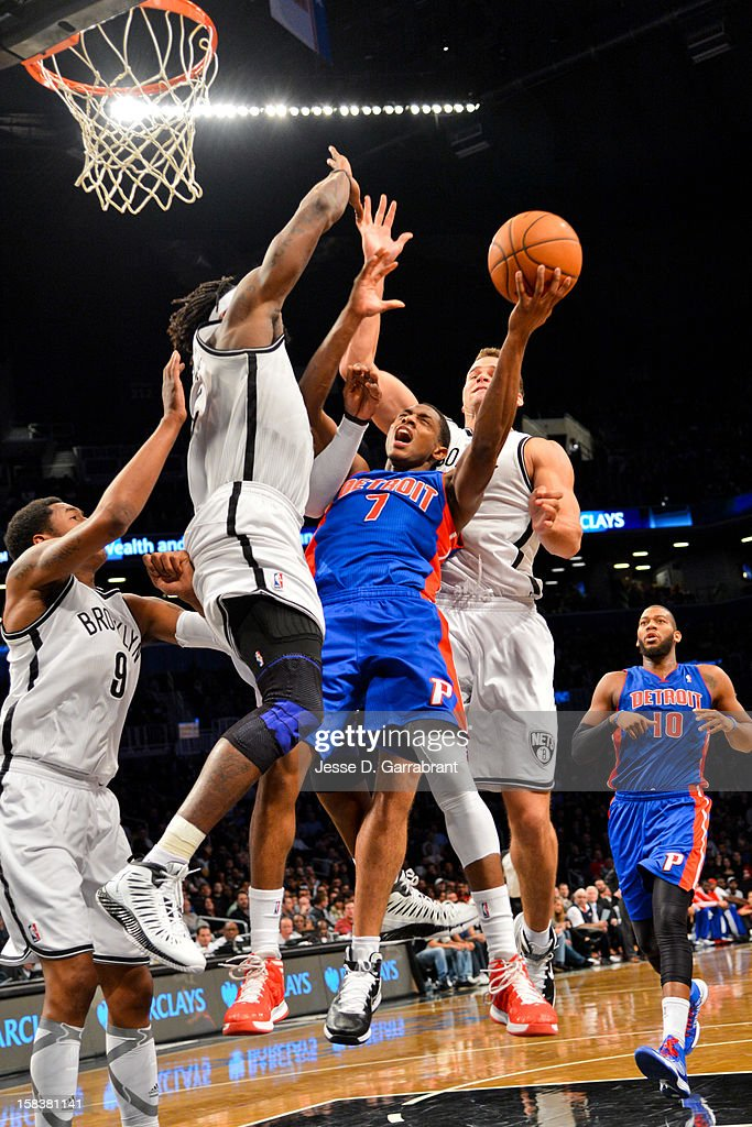 Brandon Knight #7 of the Detroit Pistons drives to the basket against Gerald Wallace #45 and Kris Humphries #43 of the Brooklyn Nets at the Barclays Center on December 14, 2012 in the Brooklyn borough of New York City.