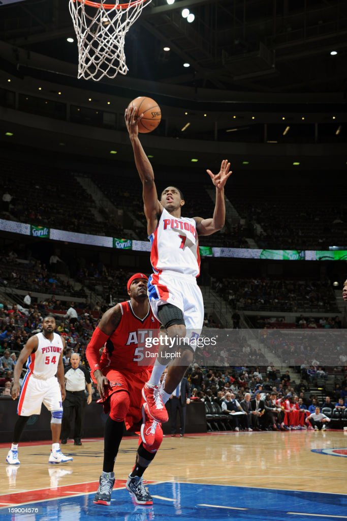 Brandon Knight #7 of the Detroit Pistons drives to the basket against <a gi-track='captionPersonalityLinkClicked' href=/galleries/search?phrase=Josh+Smith+-+Basketball+Player+-+Born+1985&family=editorial&specificpeople=201983 ng-click='$event.stopPropagation()'>Josh Smith</a> #5 of the Atlanta Hawks on January 4, 2013 at The Palace of Auburn Hills in Auburn Hills, Michigan.