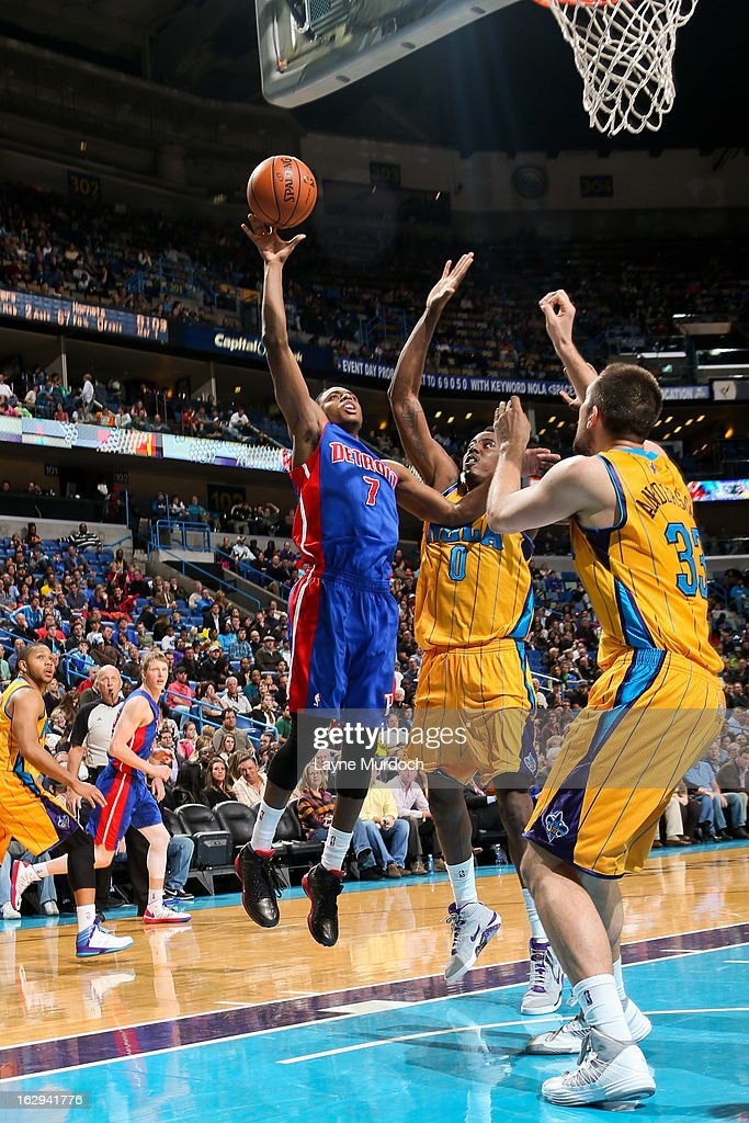 Brandon Knight #7 of the Detroit Pistons drives to the basket against Al-Farouq Aminu #0 and Ryan Anderson #33 of the New Orleans Hornets on March 1, 2013 at the New Orleans Arena in New Orleans, Louisiana.