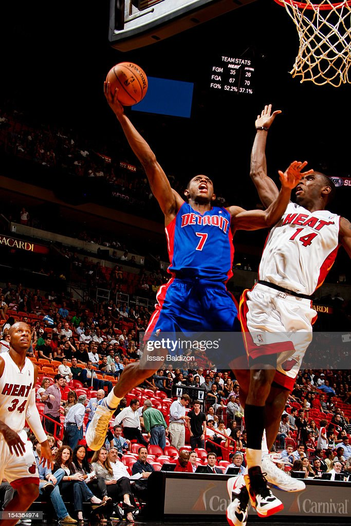 Brandon Knight #7 of the Detroit Pistons goes to the basket against <a gi-track='captionPersonalityLinkClicked' href=/galleries/search?phrase=Terrel+Harris&family=editorial&specificpeople=835465 ng-click='$event.stopPropagation()'>Terrel Harris</a> #14 of the Miami Heat during a pre-season game on October 18, 2012 at American Airlines Arena in Miami, Florida.