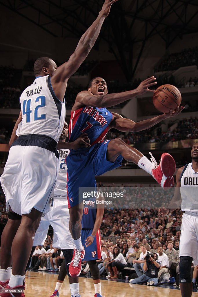 Brandon Knight #7 of the Detroit Pistons goes to the basket against <a gi-track='captionPersonalityLinkClicked' href=/galleries/search?phrase=Elton+Brand&family=editorial&specificpeople=201501 ng-click='$event.stopPropagation()'>Elton Brand</a> #42 of the Dallas Mavericks on December 1, 2012 at the American Airlines Center in Dallas, Texas.