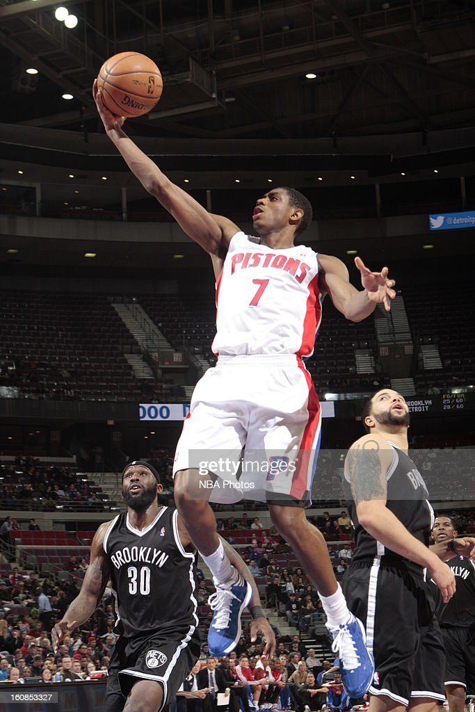 Brandon Knight #7 of the Detroit Pistons goes to the basket against <a gi-track='captionPersonalityLinkClicked' href=/galleries/search?phrase=Reggie+Evans&family=editorial&specificpeople=202254 ng-click='$event.stopPropagation()'>Reggie Evans</a> #30 and <a gi-track='captionPersonalityLinkClicked' href=/galleries/search?phrase=Deron+Williams&family=editorial&specificpeople=203215 ng-click='$event.stopPropagation()'>Deron Williams</a> #8 of the Brooklyn Nets on February 6, 2013 at The Palace of Auburn Hills in Auburn Hills, Michigan.