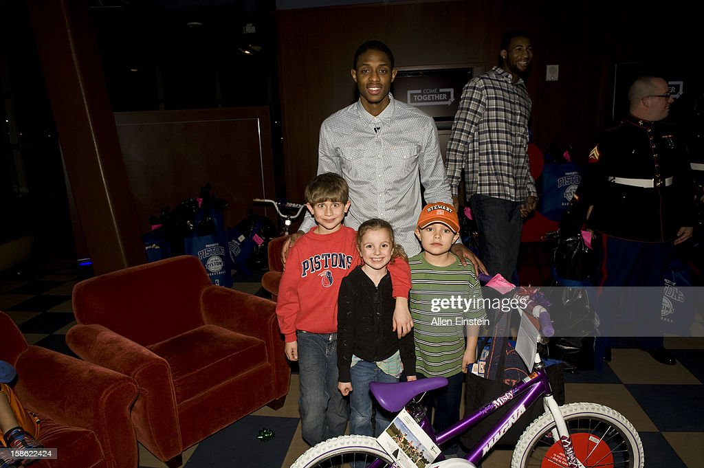 Brandon Knight of the Detroit Pistons, helps distribute holiday presents during the Detroit Pistons Toys for Tots Holiday event for metro Detroit families at the Palace of Auburn Hills on December 20, 2012 in Auburn Hills, Michigan.