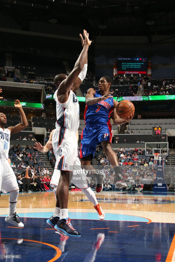 Brandon Knight #7 of the Detroit Pistons passes the ball against Bismack Biyombo #0 and the Charlotte Bobcats at the Time Warner Cable Arena on February 20, 2013 in Charlotte, North Carolina.