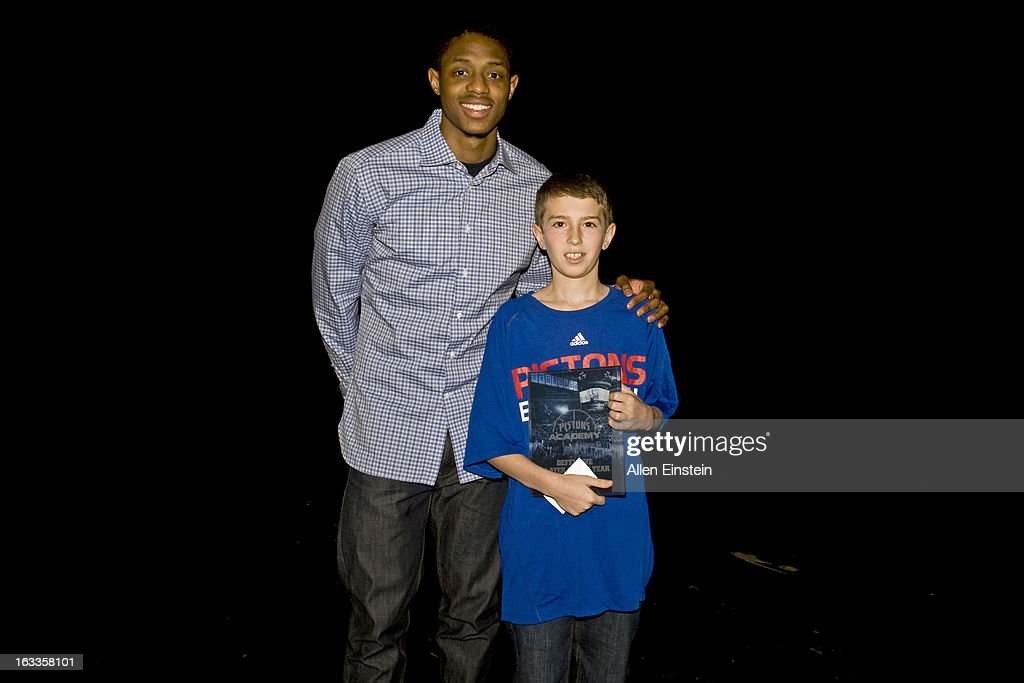 Brandon Knight #7 of the Detroit Pistons poses with award winner during the Pistons Academy Awards ceremony at Birmingham Groves High School on March 7, 2013 in Birmingham, Michigan.