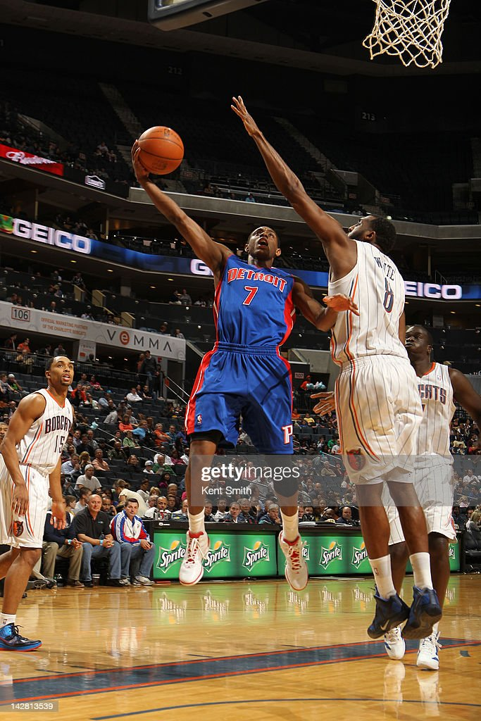 Brandon Knight #7 of the Detroit Pistons shoots against DJ White #8 of the Charlotte Bobcats at the Time Warner Cable Arena on April 12, 2012 in Charlotte, North Carolina.