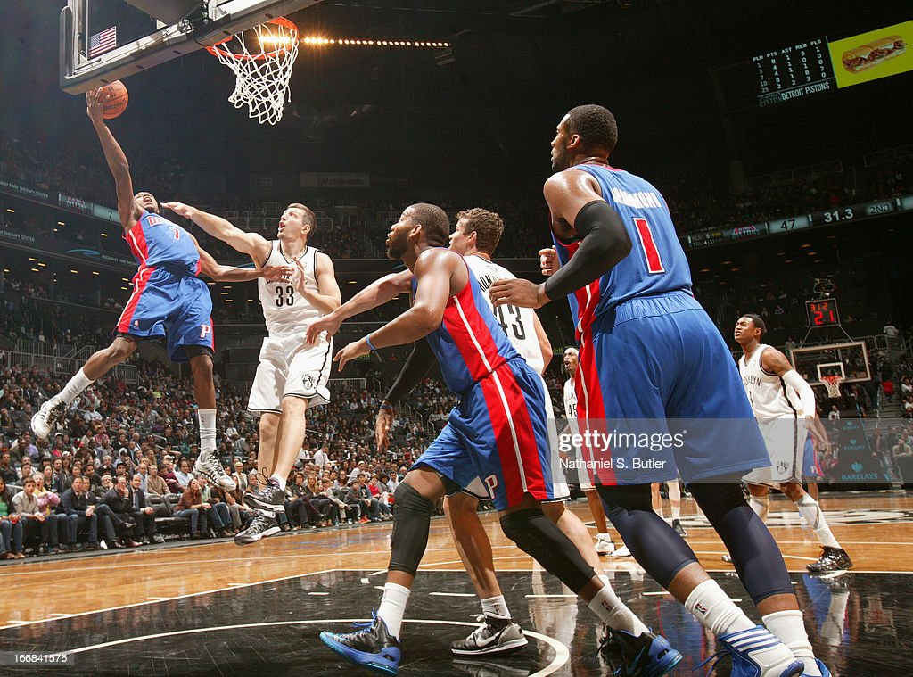 Brandon Knight #7 of the Detroit Pistons shoots against Mirza Teletovic #33 of the Brooklyn Nets on April 17, 2013 at the Barclays Center in the Brooklyn borough of New York City.