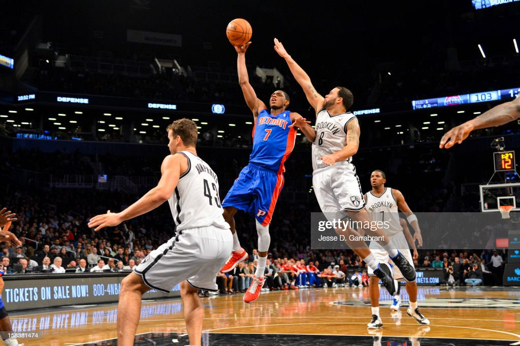 Brandon Knight #7 of the Detroit Pistons shoots in the lane against Deron Williams #8 of the Brooklyn Nets at the Barclays Center on December 14, 2012 in the Brooklyn borough of New York City.
