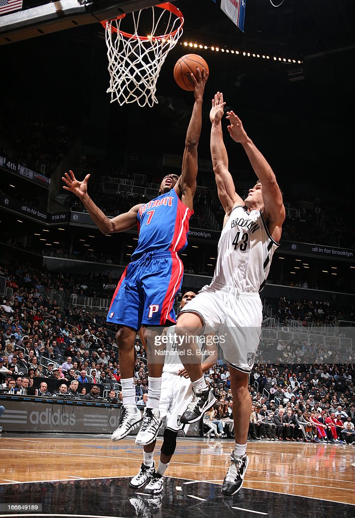 Brandon Knight #7 of the Detroit Pistons shoots past Kris Humphries #43 of the Brooklyn Nets on April 17, 2013 at the Barclays Center in the Brooklyn borough of New York City.