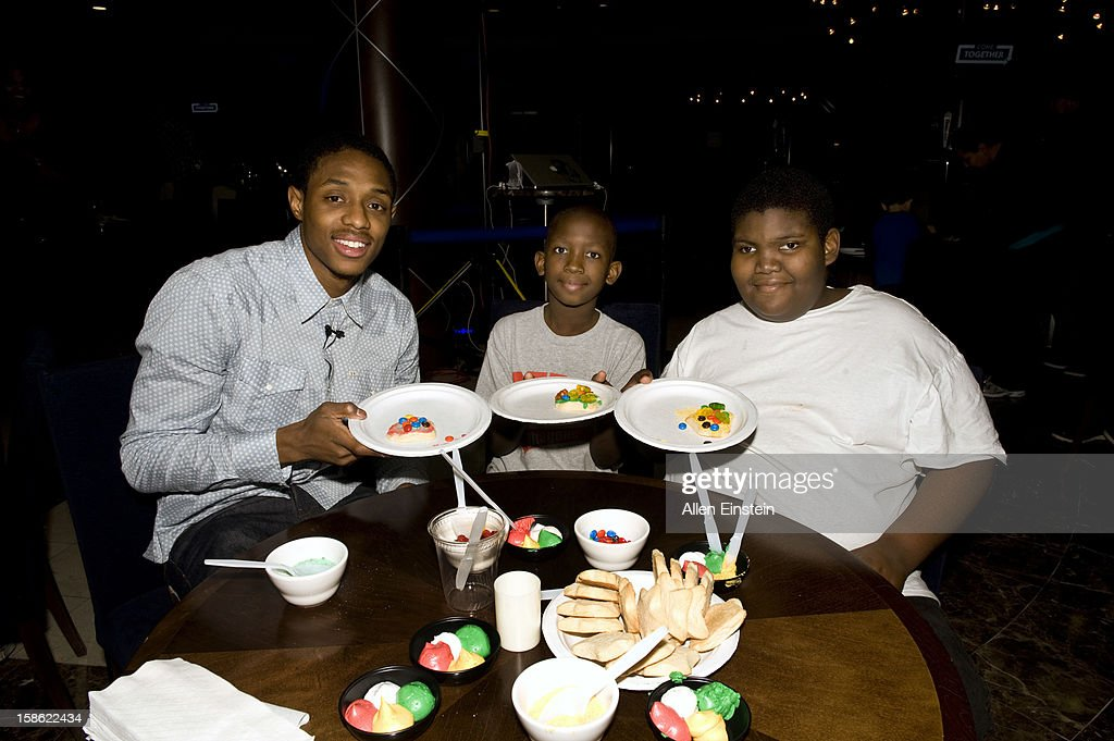 Brandon Knight of the Detroit Pistons, shows off his cookie decorating skills during the Detroit Pistons Toys for Tots Holiday event for metro Detroit families at the Palace of Auburn Hills on December 20, 2012 in Auburn Hills, Michigan.