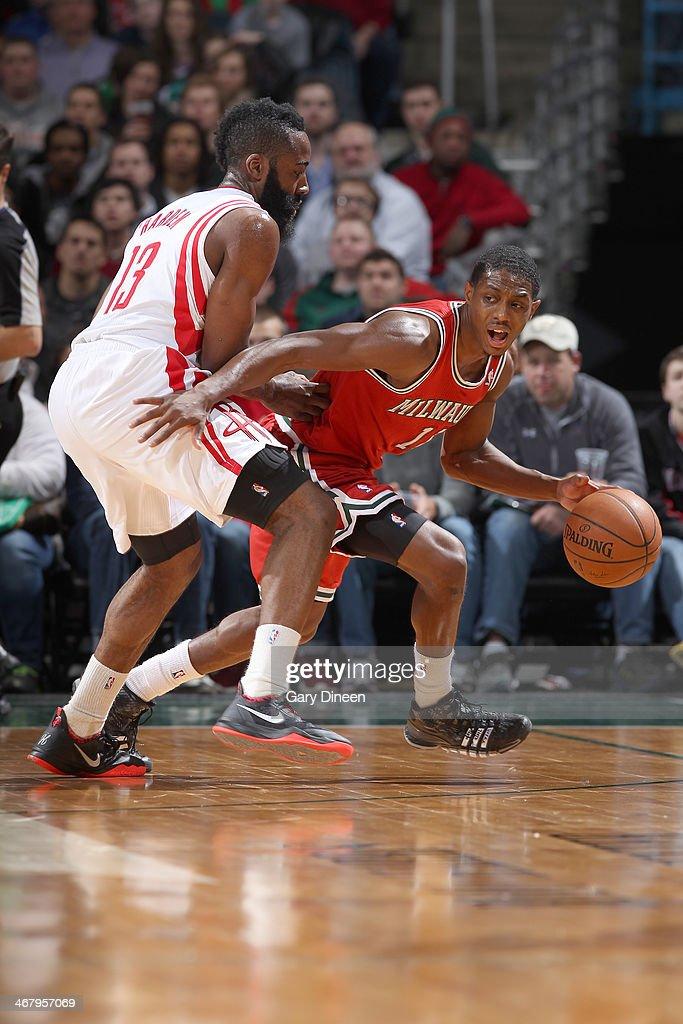 Brandon Knight #11 of the Milwaukee Bucks dribbles against James Harden #13 of the Houston Rockets on February 8, 2014 at the BMO Harris Bradley Center in Milwaukee, Wisconsin.