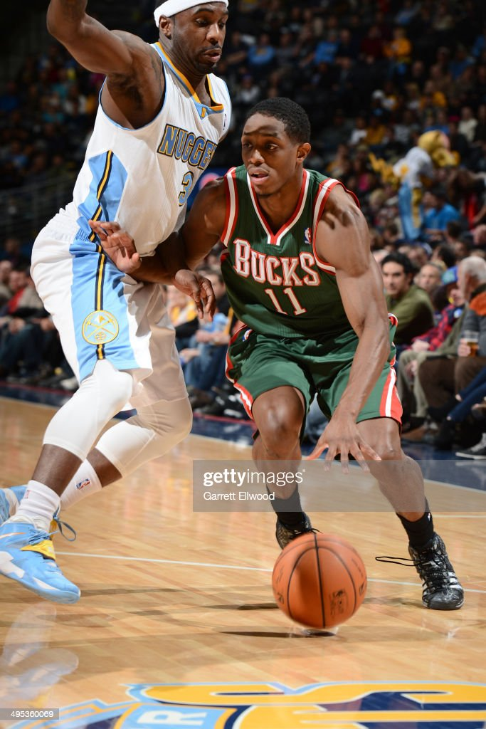 Brandon Knight #11 of the Milwaukee Bucks dribbles the ball against Ty Lawson #3 of the Denver Nuggets on February 5, 2014 at the Pepsi Center in Denver, Colorado.