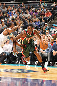 Brandon Knight of the Milwaukee Bucks drives against the Charlotte Hornets during the game at the Time Warner Cable Arena on December 29 2014 in...