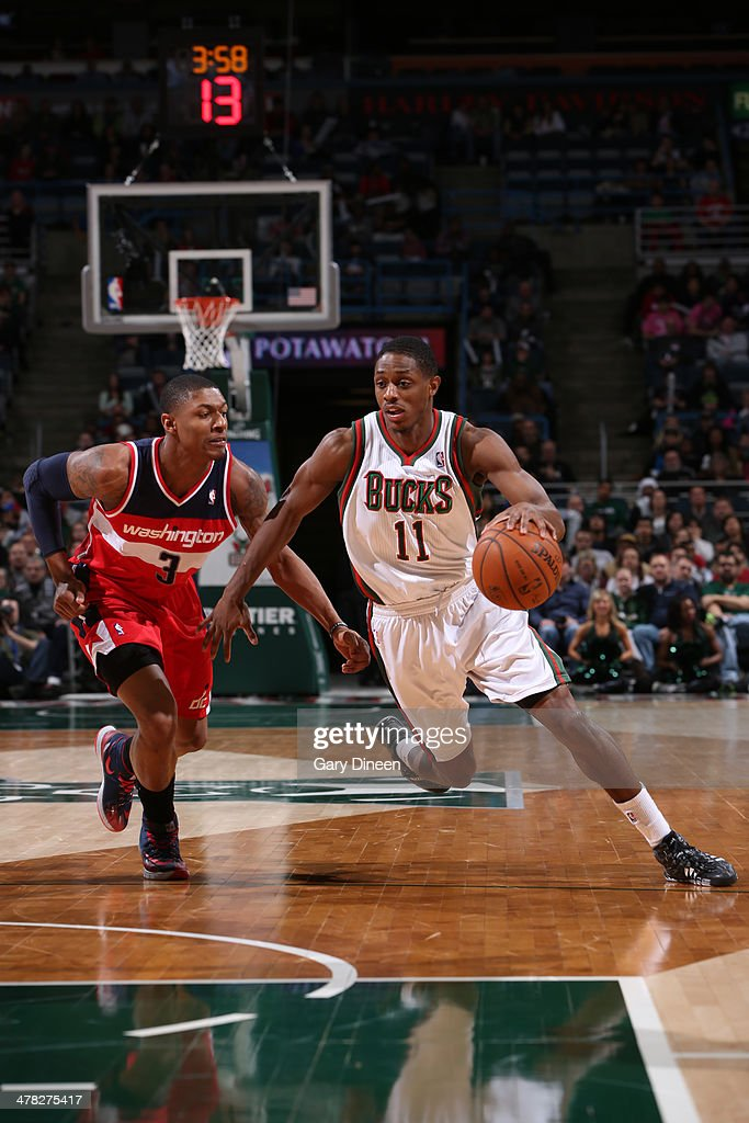 Brandon Knight #11 of the Milwaukee Bucks drives against the Washington Wizards on March 8, 2014 at the BMO Harris Bradley Center in Milwaukee, Wisconsin.