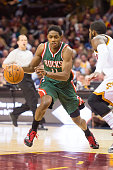 Brandon Knight of the Milwaukee Bucks drives around Kyrie Irving of the Cleveland Cavaliers during the first half at Quicken Loans Arena on December...