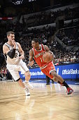 Brandon Knight of the Milwaukee Bucks drives to the basket against Tiago Splitter of the San Antonio Spurs on January 25 2015 at the ATT Center in...