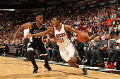 Brandon Knight of the Milwaukee Bucks drives to the basket against the Miami Heat on January 27 2015 at American Airlines Arena in Miami Florida NOTE...
