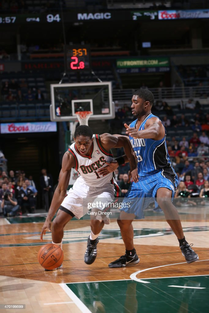 Brandon Knight #11 of the Milwaukee Bucks drives to the basket against <a gi-track='captionPersonalityLinkClicked' href=/galleries/search?phrase=E%27Twaun+Moore&family=editorial&specificpeople=4877476 ng-click='$event.stopPropagation()'>E'Twaun Moore</a> #55 of the Orlando Magic on February 18, 2014 at the BMO Harris Bradley Center in Milwaukee, Wisconsin.