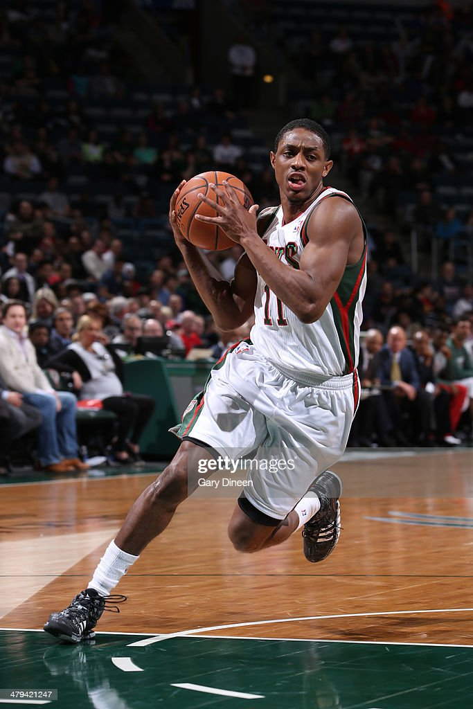 Brandon Knight #11 of the Milwaukee Bucks drives to the basket against the Orlando Magic on March 10, 2014 at the BMO Harris Bradley Center in Milwaukee, Wisconsin.