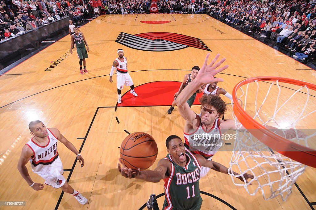 Brandon Knight #11 of the Milwaukee Bucks drives to the basket against the Portland Trail Blazers on March 18, 2014 at the Moda Center Arena in Portland, Oregon.