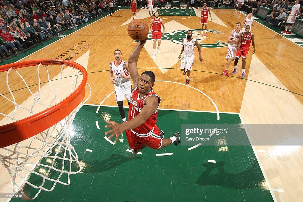 Brandon Knight #11 of the Milwaukee Bucks dunks against the Houston Rockets on February 8, 2014 at the BMO Harris Bradley Center in Milwaukee, Wisconsin.