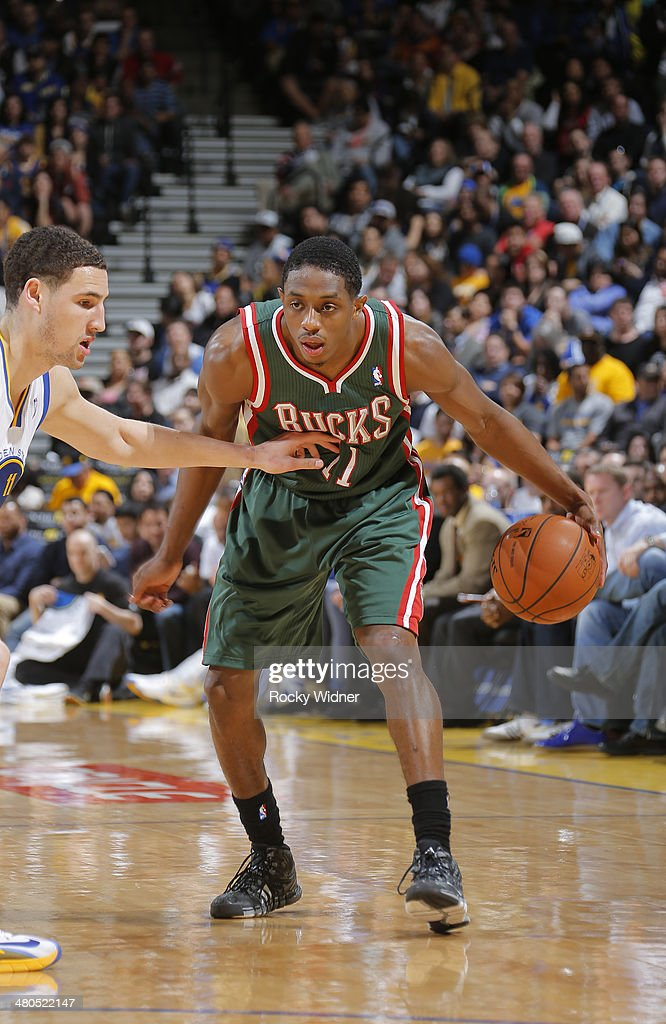 Brandon Knight #11 of the Milwaukee Bucks handles the ball against <a gi-track='captionPersonalityLinkClicked' href=/galleries/search?phrase=Klay+Thompson&family=editorial&specificpeople=5132325 ng-click='$event.stopPropagation()'>Klay Thompson</a> #11 of the Golden State Warriors on March 20, 2014 at Oracle Arena in Oakland, California.