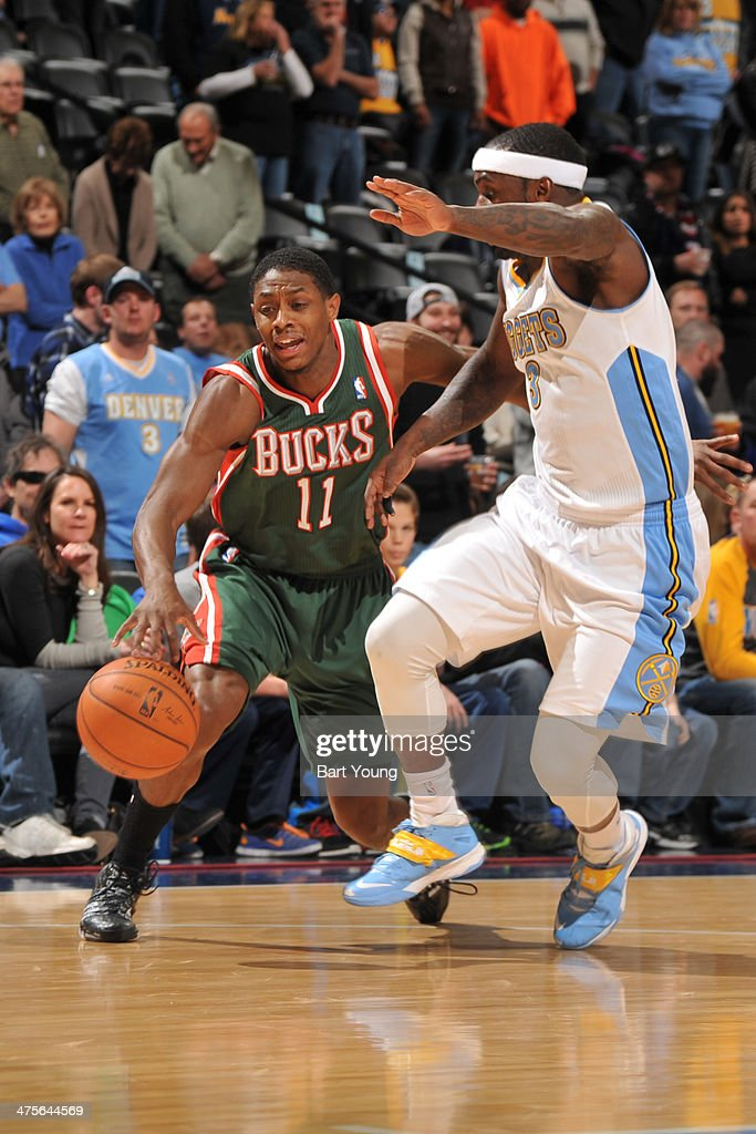 Brandon Knight #11 of the Milwaukee Bucks handles the ball against the Denver Nuggets on February 5, 2014 at the Pepsi Center in Denver, Colorado.