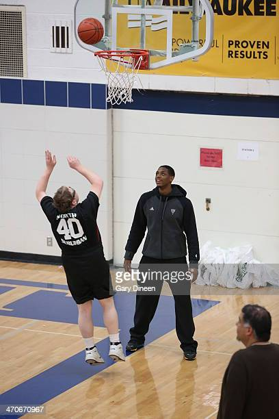 Brandon Knight of the Milwaukee Bucks interacts with participants during a Special Olympics basketball skills clinic on February 11 2014 at Nicolet...