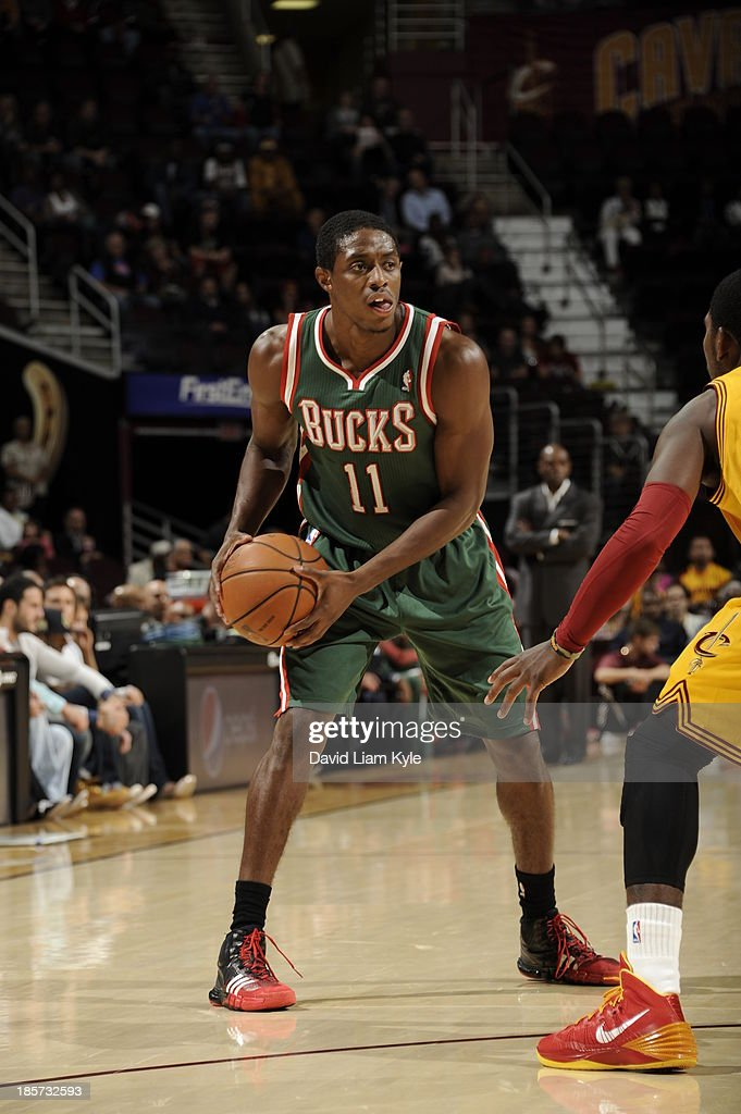 Brandon Knight #11 of the Milwaukee Bucks looks to pass the ball against the Cleveland Cavaliers at The Quicken Loans Arena on October 8, 2013 in Cleveland, Ohio.