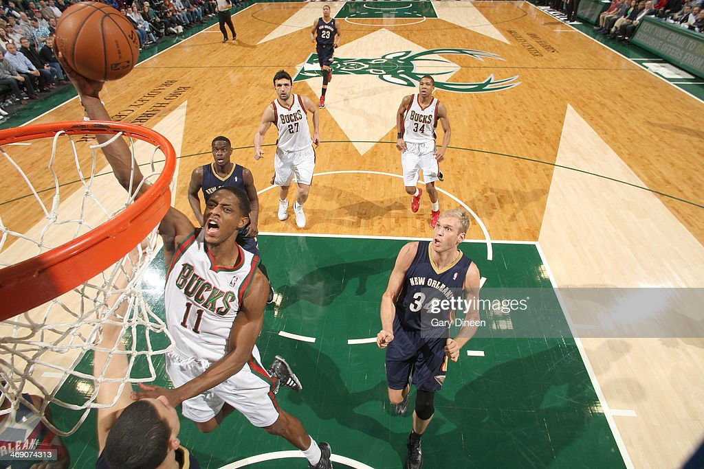 Brandon Knight #11 of the Milwaukee Bucks shoots against Austin Rivers #25 of the New Orleans Pelicans on February 12, 2014 at the BMO Harris Bradley Center in Milwaukee, Wisconsin.