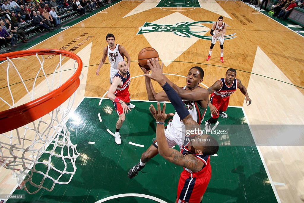 Brandon Knight #11 of the Milwaukee Bucks shoots against Bradley Beal #3 of the Washington Wizards on March 8, 2014 at the BMO Harris Bradley Center in Milwaukee, Wisconsin.