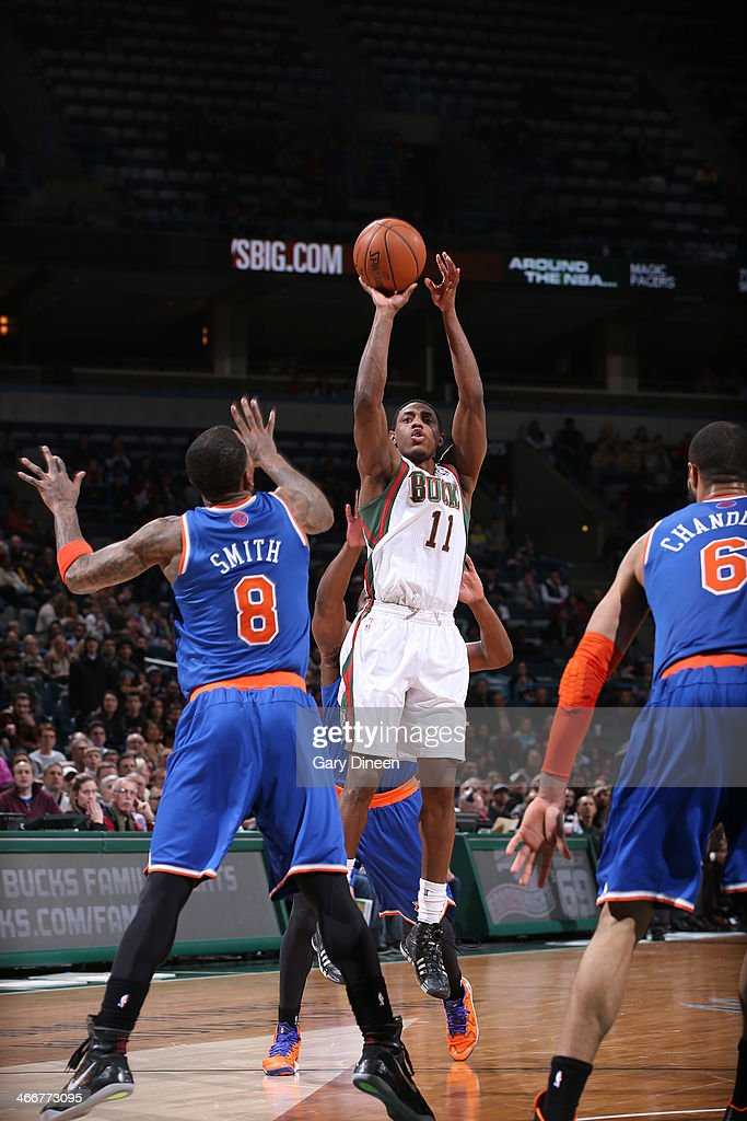 Brandon Knight #11 of the Milwaukee Bucks shoots against <a gi-track='captionPersonalityLinkClicked' href=/galleries/search?phrase=J.R.+Smith&family=editorial&specificpeople=201766 ng-click='$event.stopPropagation()'>J.R. Smith</a> #8 of the New York Knicks on February 3, 2014 at the BMO Harris Bradley Center in Milwaukee, Wisconsin.