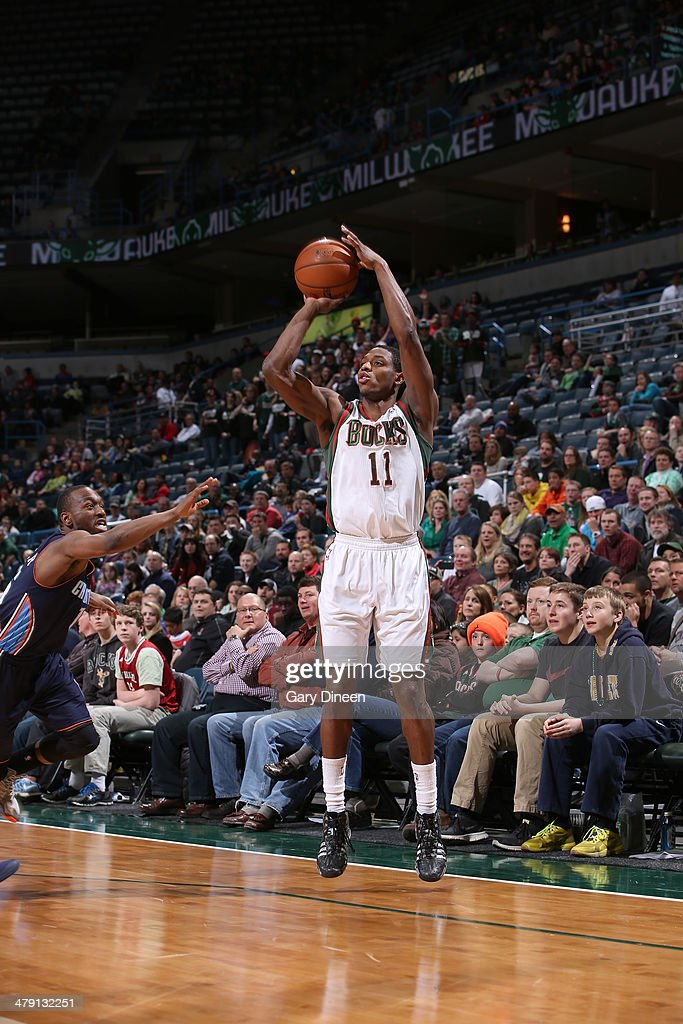 Brandon Knight #11 of the Milwaukee Bucks shoots against Kemba Walker #15 of the Charlotte Bobcats on March 16, 2014 at the BMO Harris Bradley Center in Milwaukee, Wisconsin.