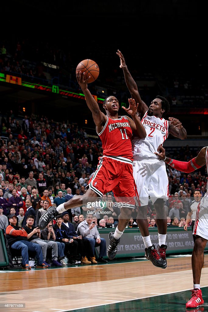 Brandon Knight #11 of the Milwaukee Bucks shoots against Patrick Beverly #2 of the Houston Rockets on February 8, 2014 at the BMO Harris Bradley Center in Milwaukee, Wisconsin.