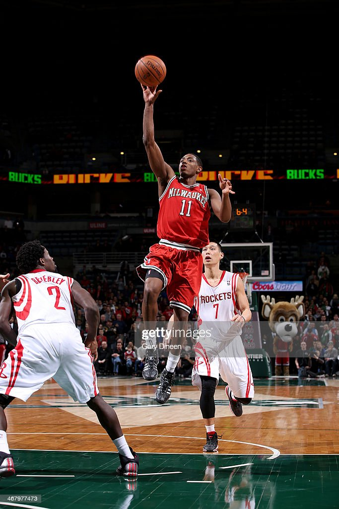 Brandon Knight #11 of the Milwaukee Bucks shoots against the Houston Rockets on February 8, 2014 at the BMO Harris Bradley Center in Milwaukee, Wisconsin.
