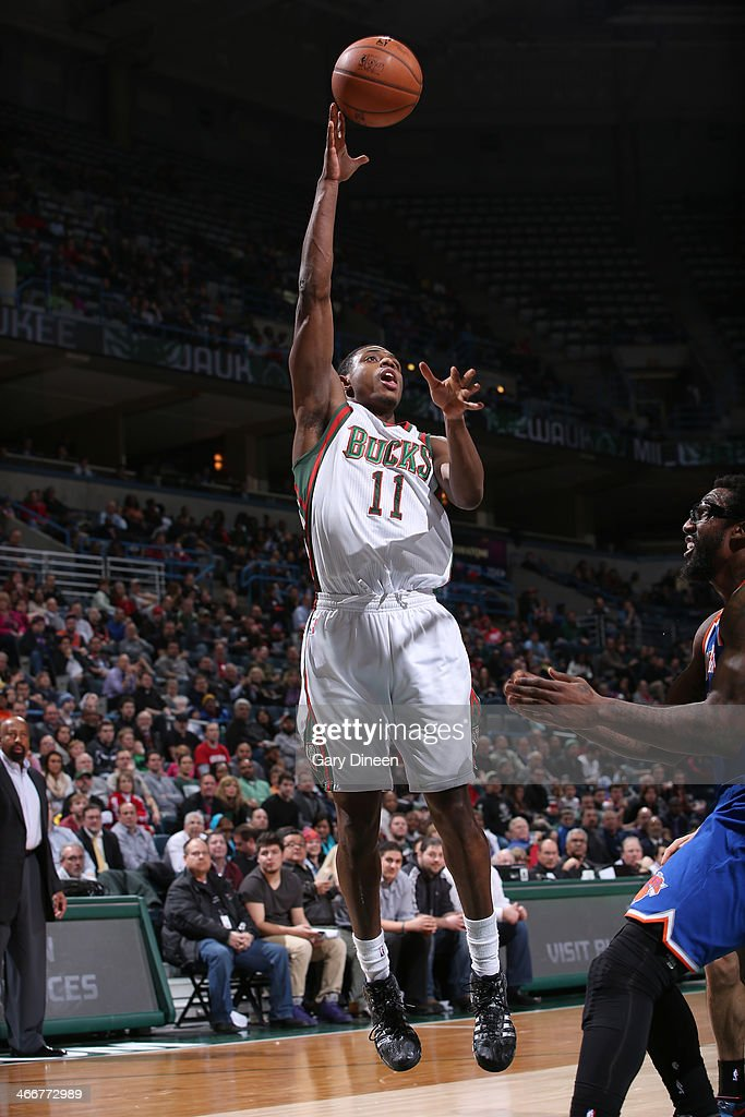 Brandon Knight #11 of the Milwaukee Bucks shoots against the New York Knicks on February 3, 2014 at the BMO Harris Bradley Center in Milwaukee, Wisconsin.