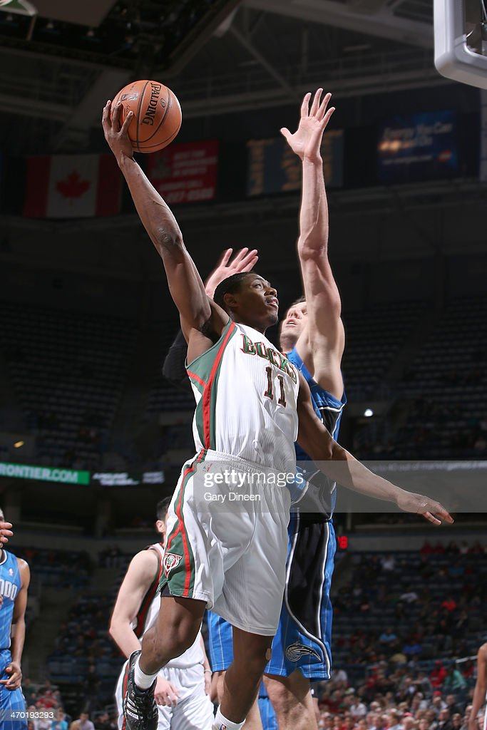 Brandon Knight #11 of the Milwaukee Bucks shoots against the Orlando Magic on February 18, 2014 at the BMO Harris Bradley Center in Milwaukee, Wisconsin.