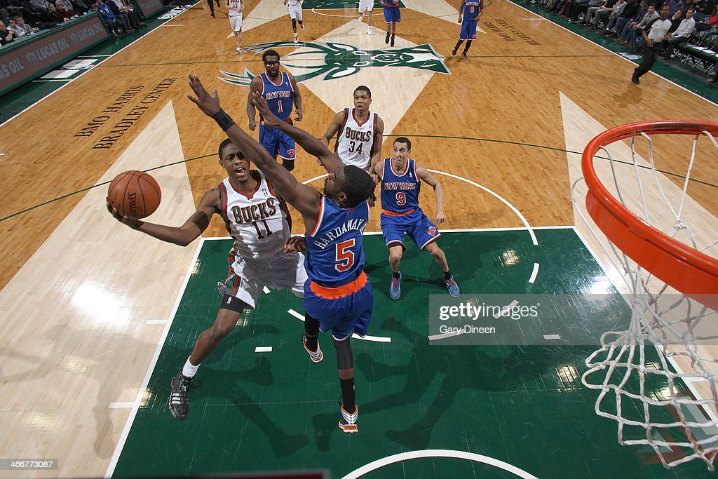 Brandon Knight #11 of the Milwaukee Bucks shoots against Tim Hardaway Jr. #5 of the New York Knicks on February 3, 2014 at the BMO Harris Bradley Center in Milwaukee, Wisconsin.