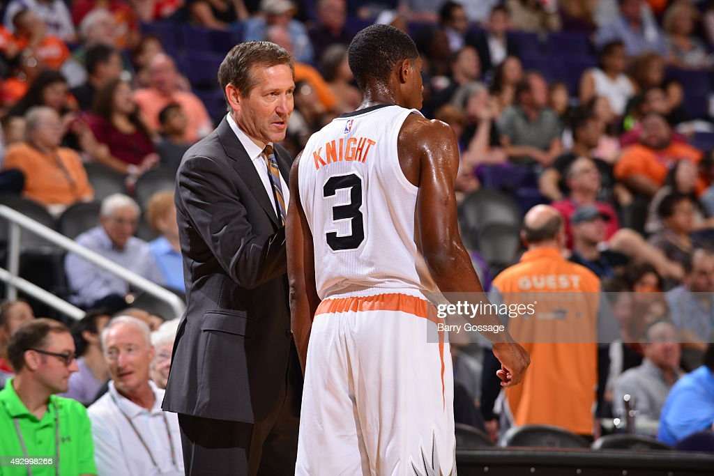 Brandon Knight of the Phoenix Suns and head coach Jeff Hornacek of the Phoenix Suns talk against the Utah Jazz during a preseason game on October 9...