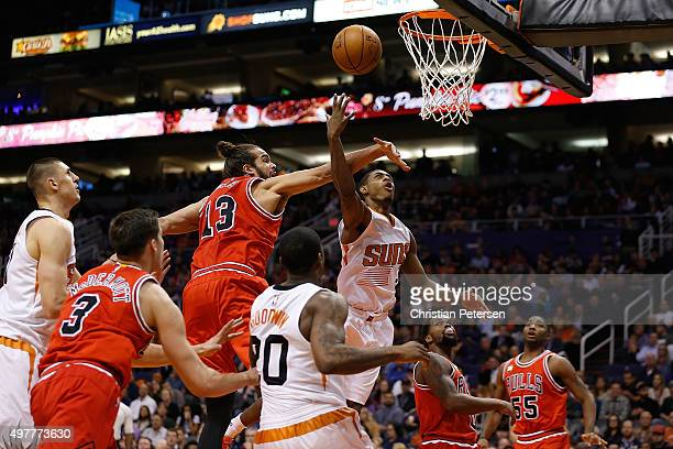 Brandon Knight of the Phoenix Suns attempts a shot past Joakim Noah of the Chicago Bulls during the first half of the NBA game at Talking Stick...