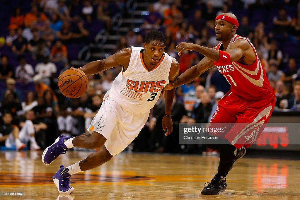 Brandon Knight of the Phoenix Suns drives the ball past Jason Terry of the Houston Rockets during the second half of the preseason NBA game at...