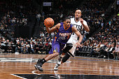 Brandon Knight of the Phoenix Suns drives to the basket against the Brooklyn Nets on March 6 2015 at Barclays Center in Brooklyn New York NOTE TO...