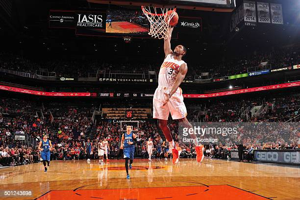 Brandon Knight of the Phoenix Suns dunks against the Minnesota Timberwolves during the game on December 13 2015 at Talking Sticks Resort Arena in...