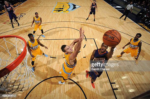 Brandon Knight of the Phoenix Suns goes to the basket against the Denver Nuggets on November 20 2015 at the Pepsi Center in Denver Colorado NOTE TO...
