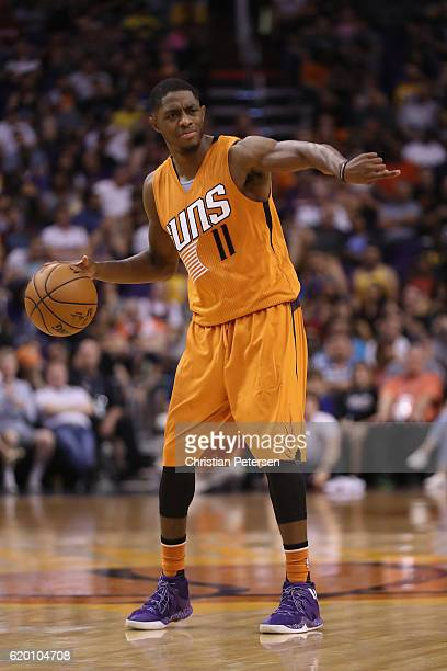 Brandon Knight of the Phoenix Suns handles the ball during the NBA game against the Golden State Warriors at Talking Stick Resort Arena on October 30...