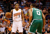 Brandon Knight of the Phoenix Suns handles the ball guarded by Avery Bradley of the Boston Celtics during the first half of the NBA game at US...