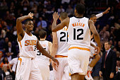 Brandon Knight of the Phoenix Suns highfives TJ Warren after scoring against the Los Angeles Lakers during the second half of the NBA game at Talking...
