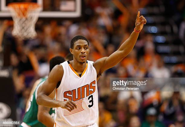 Brandon Knight of the Phoenix Suns reacts after hitting a three point shot against the Boston Celtics during the second half of the NBA game at US...