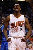 Brandon Knight of the Phoenix Suns reacts after scoring against the Orlando Magic during the second half of the NBA game at Talking Stick Resort...